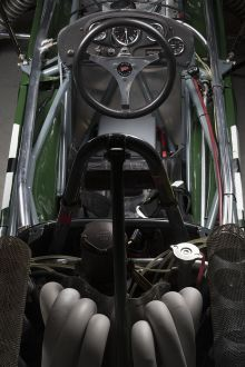 View of racing car cabin from above showing seat and steering wheel