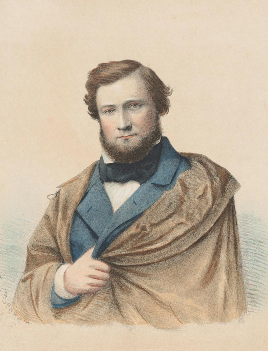 Colour image of bearded man wearing cloak concealing his missing left arm. - click to view larger image