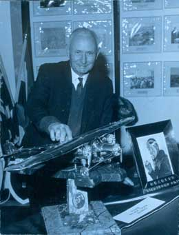 Bryne with his Southern Cross model and other components of the memorial