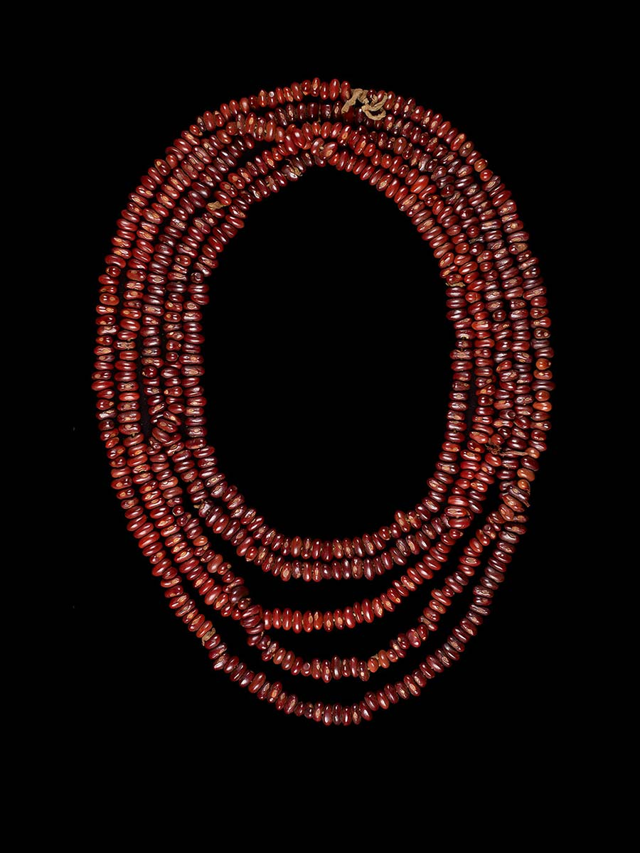 Necklace made of red seeds. - click to view larger image