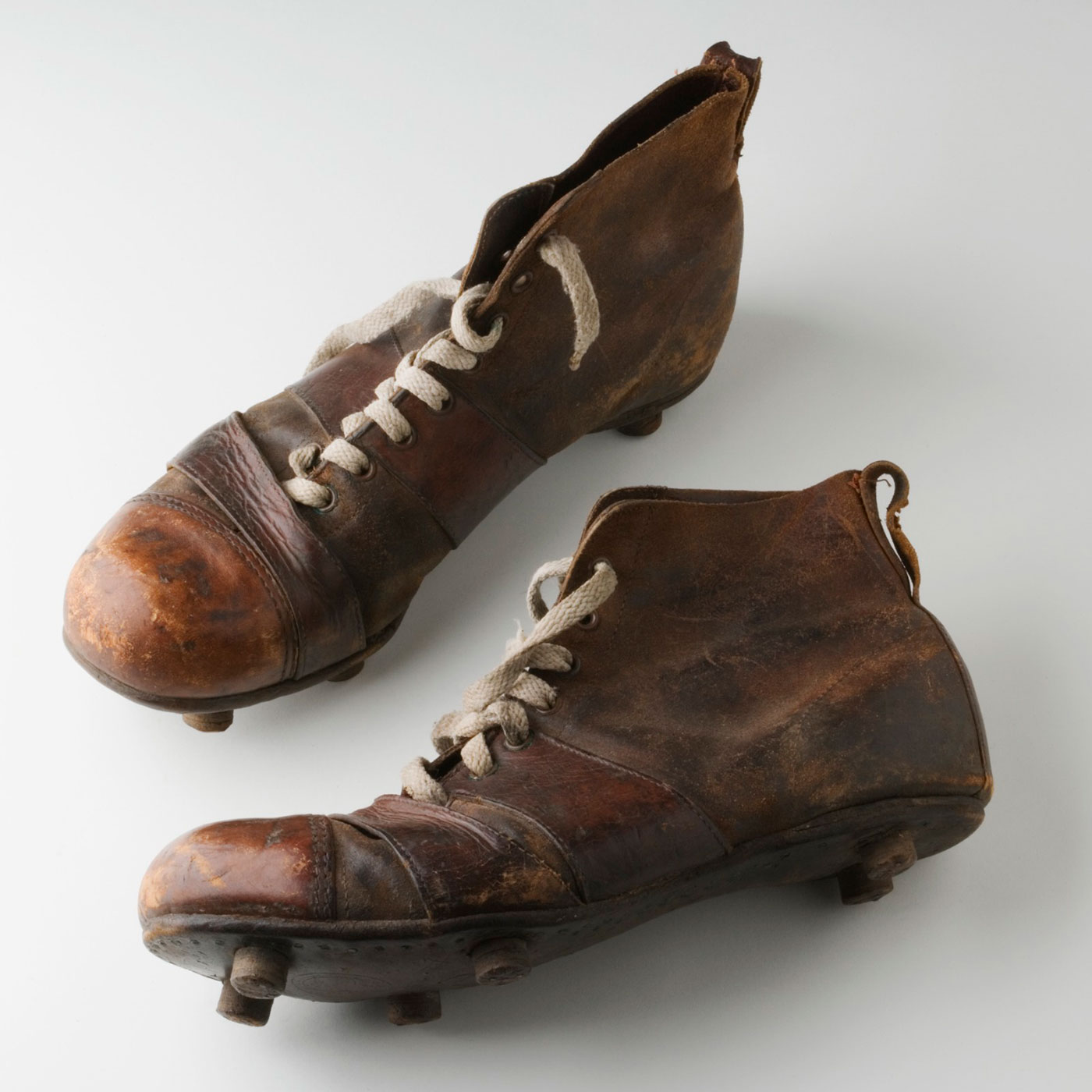 A pair of leather, high-ankle football boots. - click to view larger image