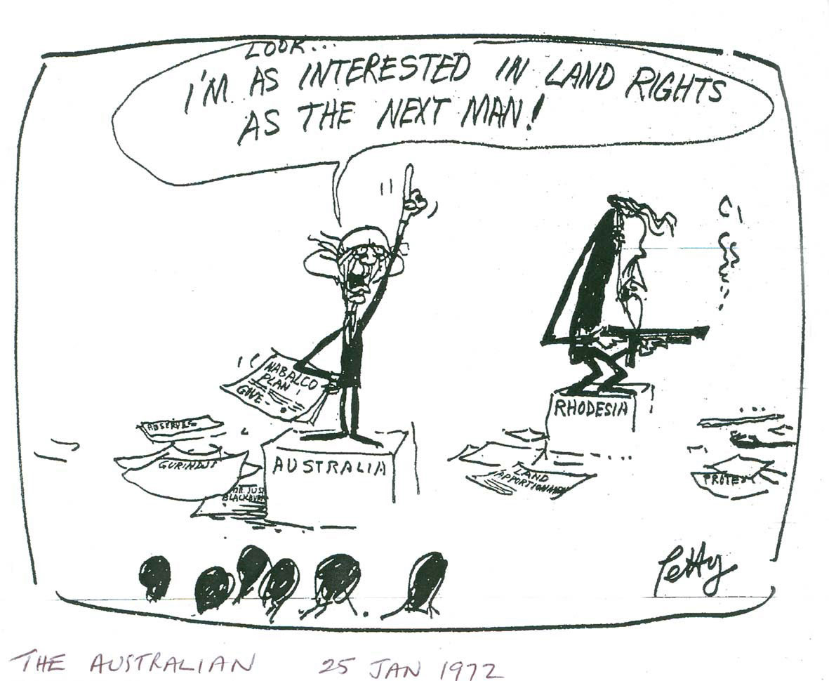Cartoon from The Australian (25 January 1972) depicting a man standing on a soap box with the text: 'AUSTRALIA'. There is a speech bubble above his head that reads: 'LOOK...I'M AS INTERESTED IN LAND RIGHTS AS THE NEXT MAN!'. Another man is standing on a soap box with the text: 'RHODESIA' and holding a smoking gun.