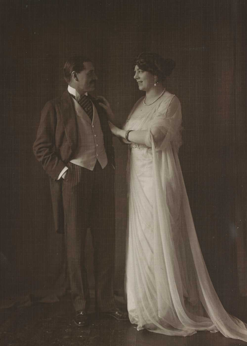 Full length studio portait of Kennerley Rumford and Clara Butt.